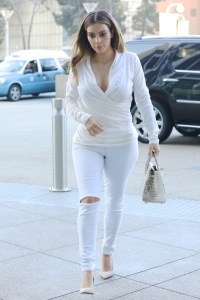 Kim Kardashian Heads To A Meeting Wearing A Sexy White Blouse & Skintight Jeans